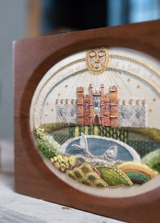 Hampton Court Sampler, in wooden casket with an oval aperture close up detail